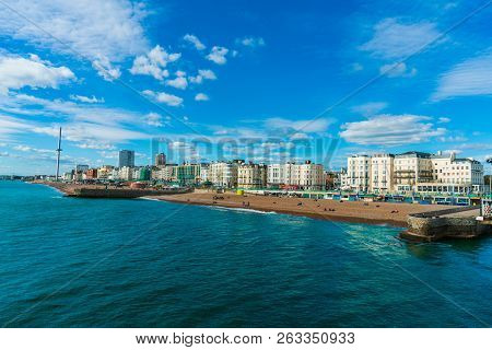 Beautiful view of Brighton Pier with Brighton beach sea, sand and blue sky in the background. Popular landmark of the city. stock photo