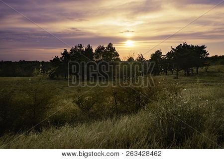 Sunset in nature landscape. Fields and countryside landscape. Nature landscape. Sunset in nature landscape. Outdoor traveling landscape. Landscape. Nature. Traveling. Orange and yellow nature landscape. stock photo