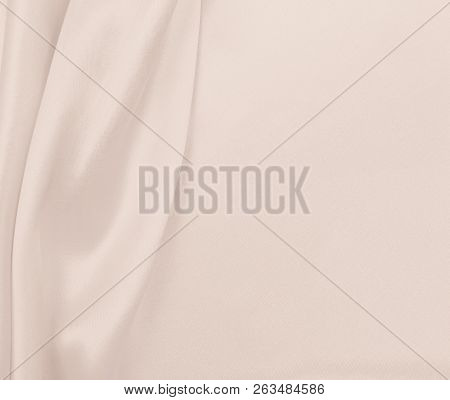Smooth elegant golden silk or satin luxury cloth texture can use as wedding background. Luxurious background design. In Sepia toned. Retro style stock photo