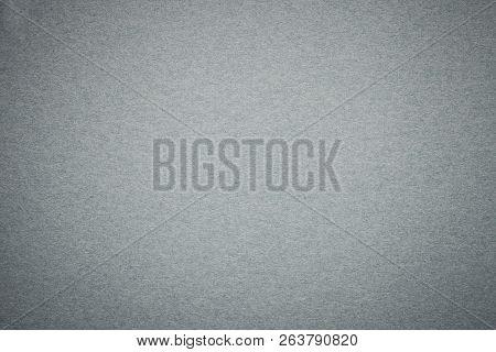 Texture of old gray paper background, closeup. Structure of dense light silver kraft cardboard. Felt gradient steel backdrop closeup. stock photo