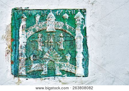 Ancient ceramic tile with fortress image in the wall of the Joseph-Volotsky monastery in Russia stock photo