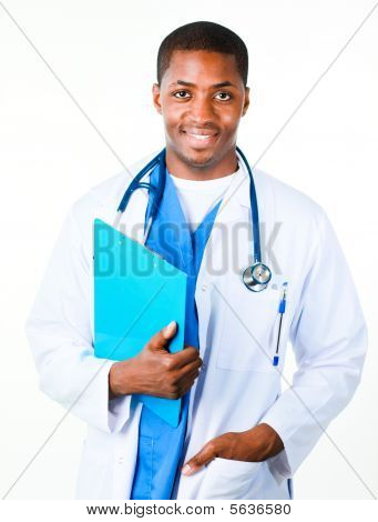 Happy Afro-American doctor holding a clipboard and looking at the camera