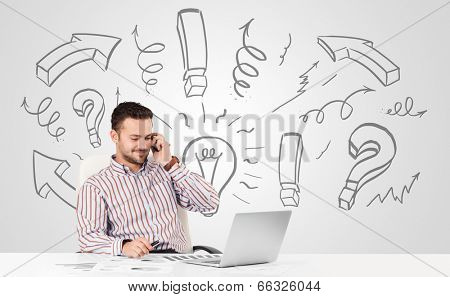 Good-looking young businessman brainstorming with drawn arrows and symbols stock photo