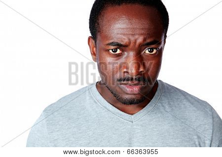 Portrait of a dissatisfied african man over white background stock photo