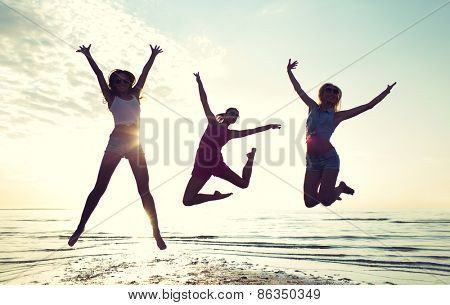 friendship, summer vacation, freedom, happiness and people concept - group of happy female friends d