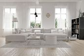 Modern extensive parlor or family room inside with monochromatic white furniture and stylistic layou