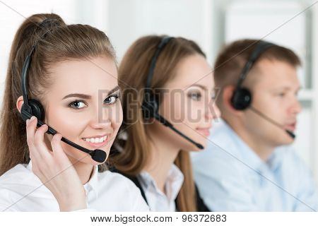 Portrait Of Call Center Worker Accompanied By Her Team