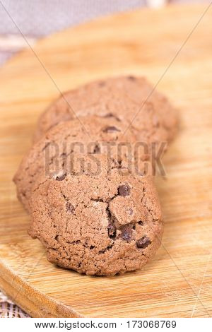 Brown chocolate biscuits on the wooden board stock photo
