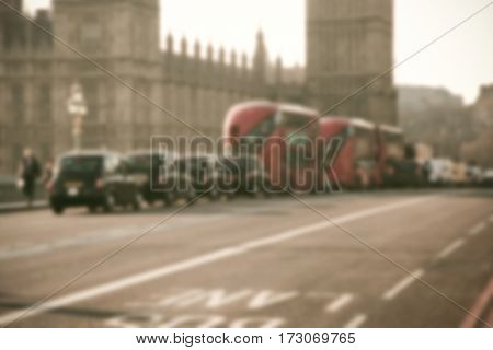 blurred background of traffic on Westminster Bridge with typical English cabs and buses stock photo