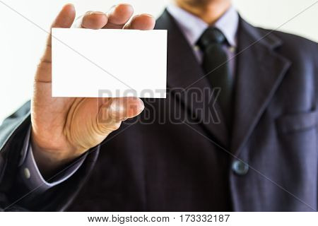 Business Man. Business man showing business card closeup on white background suitable for all business content. Business man on white background. Business man in suit. Business advertising and business people concept, business content.