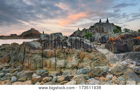The rocky escarpment of Mimosa Rocks is varied and includes a mixture of rock types including rhyolite gabbro sandstone siltstone conglomerate and metasediments. The rocks here are the result of volcanic eruptions underneath a deep lake the lake water boi stock photo