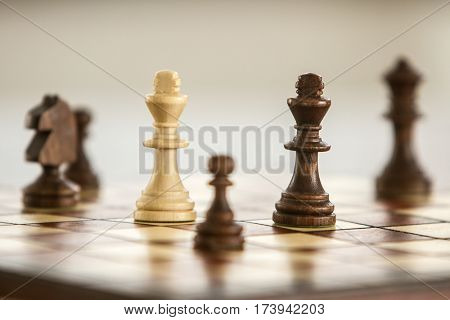 black and white chess figures on chessboard, chess game stock photo