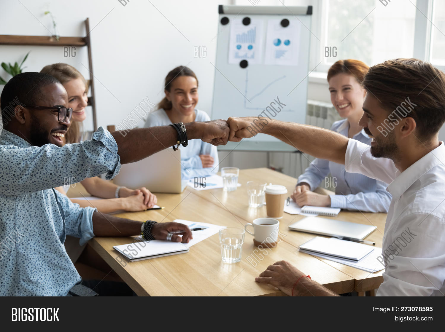 Guys Fist Bumping Congratulating Each Other With Success At Work