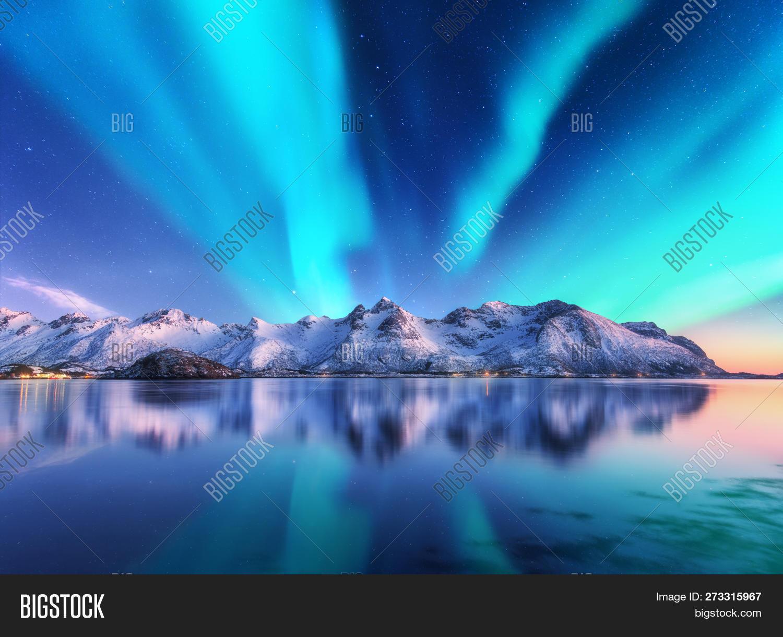 arctic,astronomy,aurora,background,beautiful,beauty,borealis,coast,cold,dusk,fjord,galaxy,green,ice,iceland,island,lake,landscape,light,lofoten,magnetic,mountain,nature,night,nordic,north,northern,norway,polar,pole,reflection,rock,scandinavia,scenery,sea,shore,sky,snow,snowy,space,star,starry,travel,twilight,universe,water,winter