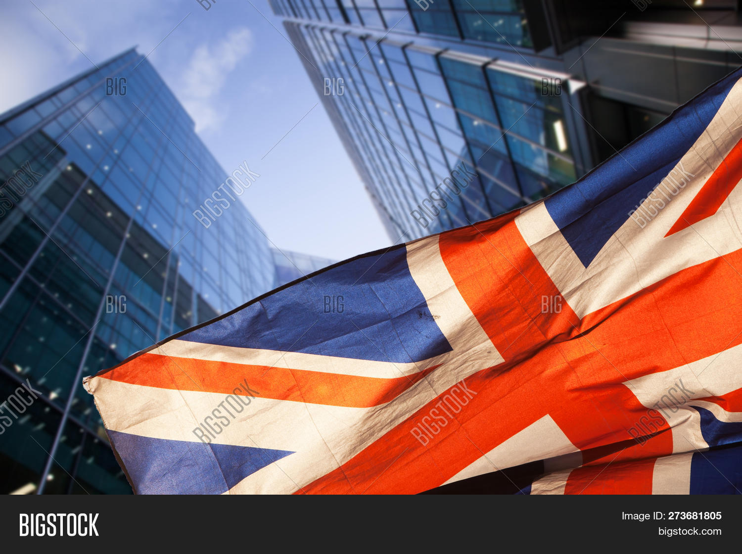 brexit concept - UK economy after Brexit deal - double exposure of flag and Canary Wharf business ce