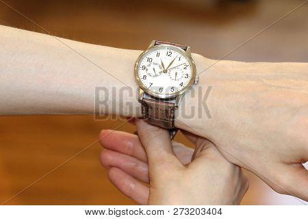 Elegant retro female wrist watch woman holding with her hand stock photo