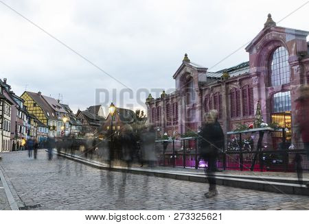 Christmas market in Colmar, people walking in the streets of the village stock photo
