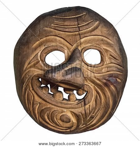 Old wooden mask. Ancient mask for the rite. Isolated on white background. stock photo