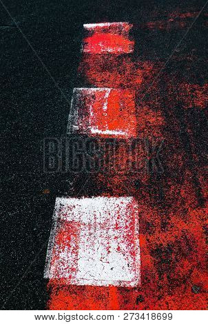Abstract colorful composition on the asphalt. Abstract sign on asphalt background. Texture of asphalt road with red and white spots, pattern of old cracked asphalt surface close up stock photo