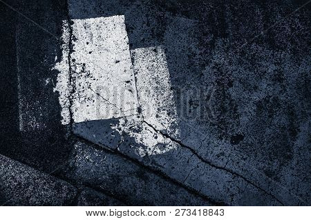 Abstract spots composition on the asphalt. Abstract sign on asphalt background. Texture of asphalt road with white spots, pattern of old cracked asphalt surface close up stock photo