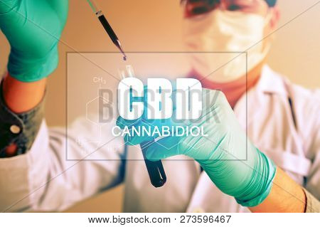 Cannabis oil, CBD concept, Chemist conducts experiments by synthesising compounds with using dropper in a test tube. stock photo