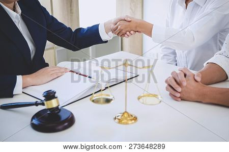 Handshake after good cooperation greeting, Having meeting with team at law firm, Consultation between a female lawyer and businesswoman customer, tax and the company of real estate concept. stock photo