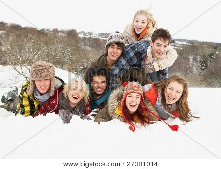 Group Of Teenage Friends Having Fun In Snowy Landscape stock photo