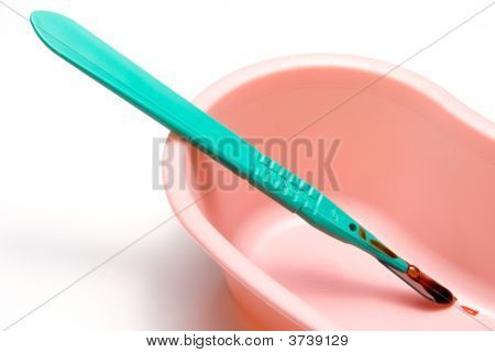 A medical scalpel after a surgical procedure. stock photo