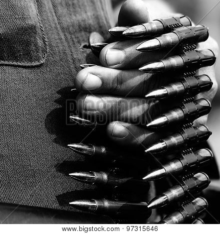 guerrilla soldier with an ammunition loader in hand during the war stock photo