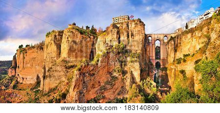 Panoramic View Of The Old City Of Ronda, One Of The Famous White Villages, At Sunset In The Province