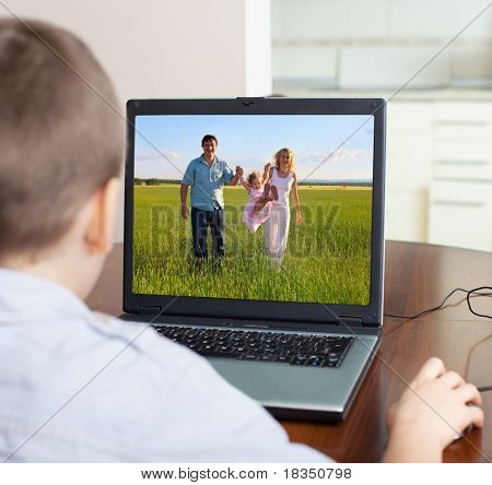 Child playing a computer at home stock photo