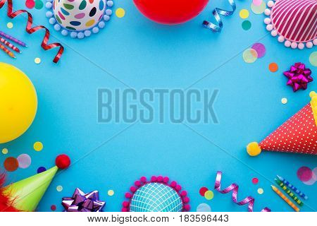Birthday party background with party hats and streamers