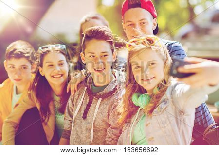 education, high school, technology and people concept - group of happy teenage students or friends t