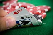 Ace of hearts and dark jack with red poker contributes the foundation.