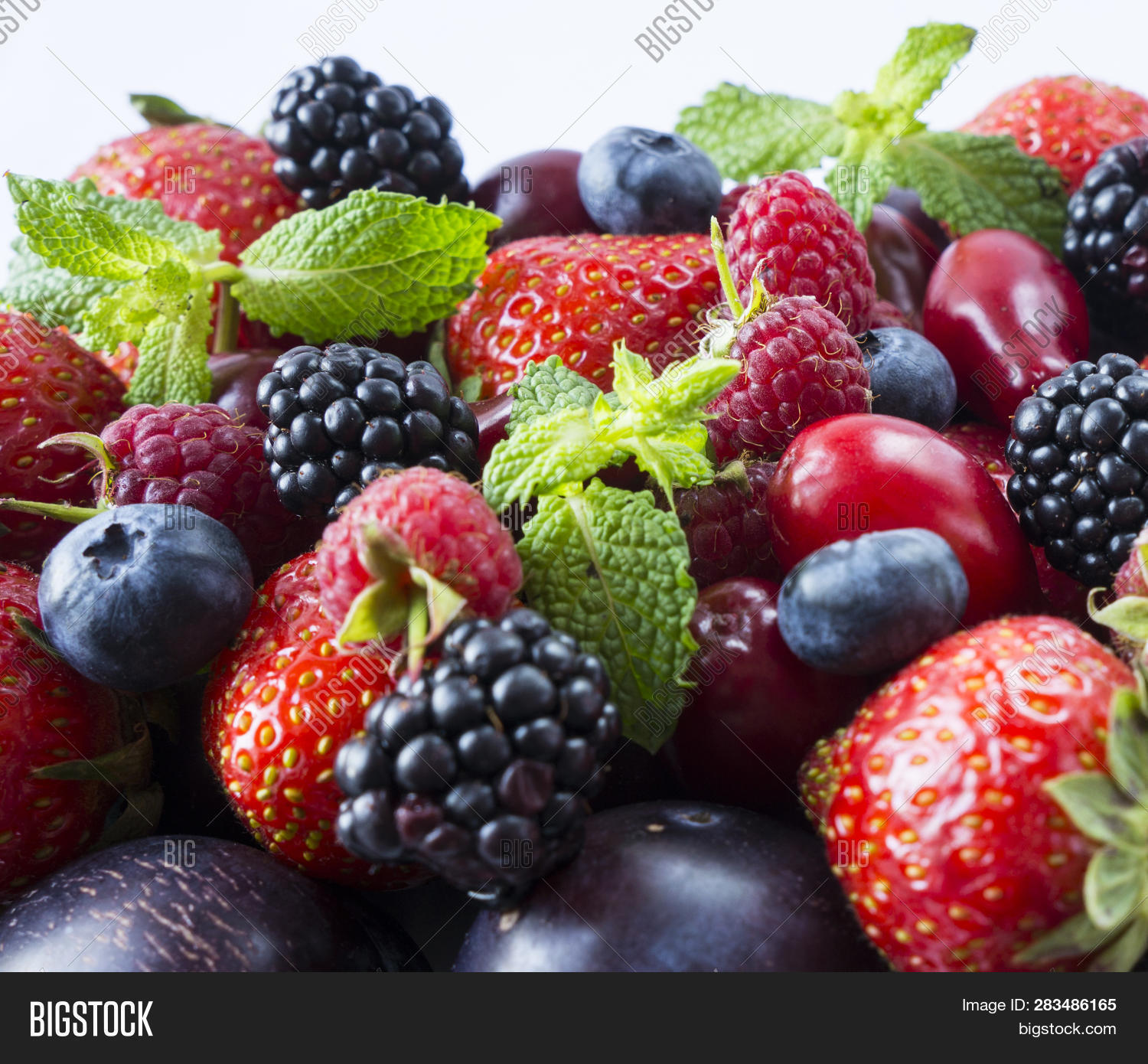 agriculture,background,berry,blackberries,blueberry,close,closeup,color,colorful,copy,cut,cutout,delicious,dessert,diet,different,food,fresh,fruit,garden,group,health,juice,juicy,kitchen,market,mix,mixed,nature,nutrition,nutritious,organic,plants,plum,raspberries,red,ripe,space,strawberry,summer,sweet,tasty,text,up,variety,vegetarian,vitamin,white