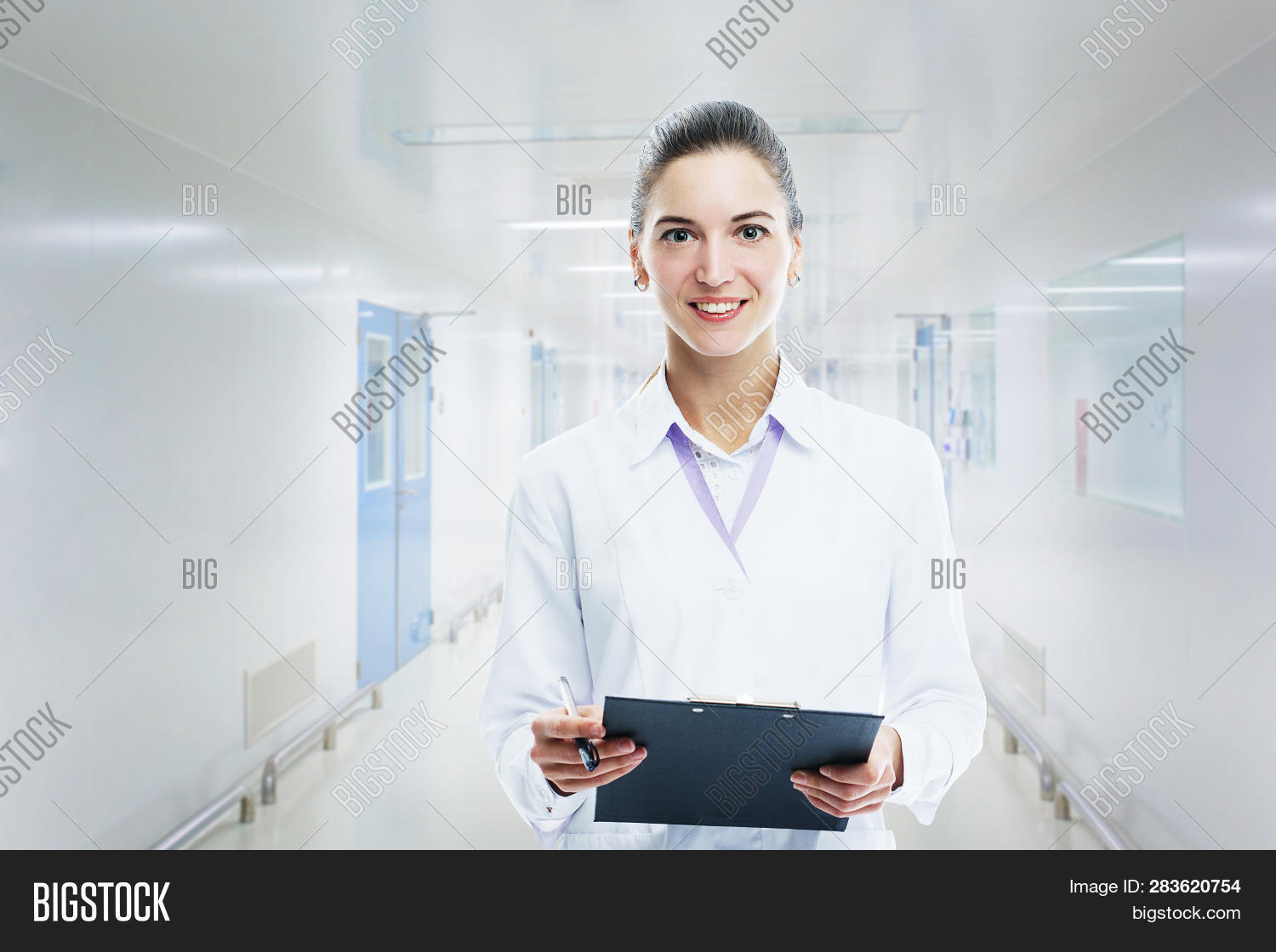 Young Woman Medic Doctor Practitioner With  Folder In White Uniform Looking With A Smile. Concept Fo