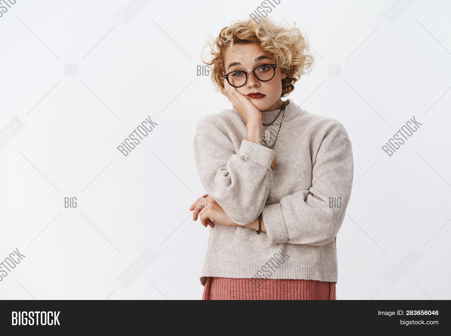 advertisement,attractive,background,beautiful,blond,blonde,bored,boring,casual,cute,emotional,expressive,eyewear,fair,female,friendly,gestures,gesturing,girl,girlfriend,glasses,gloomy,gray,happiness,hipster,holidays,horizontal,indifferent,joyful,playful,portrait,posing,positive,pretty,sad,short-hair,smile,student,studio,stylish,sweater,trendy,unbothered,uninterested,upset,valentine,winter,woman,young,youth