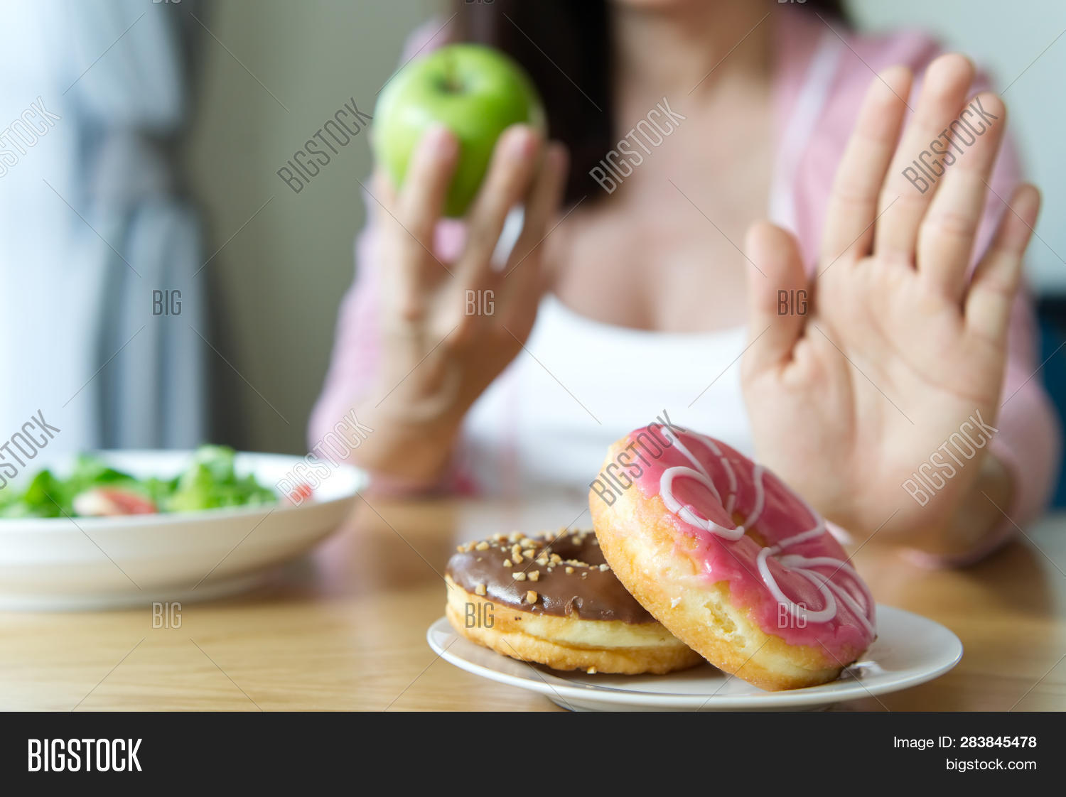 Young Girl Rejecting Junk Food Or Unhealthy Food Such As Donuts And Choosing Healthy Food Such As A