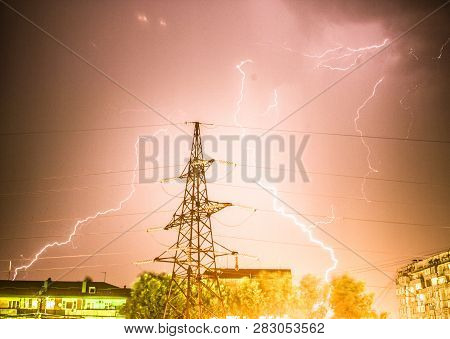Lightning flare, night, powerful, flash, bright, thundershower, black, illustration, modern, voltage, graphic, atmosphere, fractal, abstract, plasma, dangerous, climate, striking, outdoors, fantasy, rainstorm, cloud, trees, art stock photo