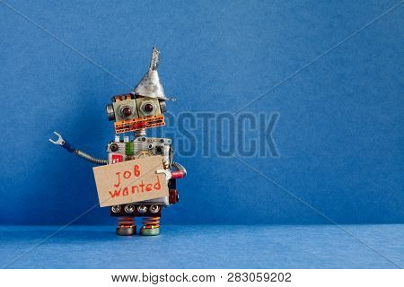 Job search concept. Robot wants to get a job. Funny unemployed robotic character with a cardboard sign and handwritten text Job wanted. Blue background, copy space stock photo