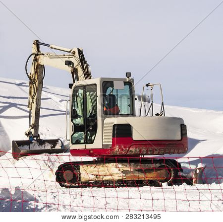Excavator or digger with shovel. Industrial machine for earth moving stock photo