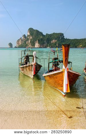 Longtail boats anchored at Ao Loh Dalum beach on Phi Phi Don Island, Krabi Province, Thailand. Koh Phi Phi Don is part of a marine national park. stock photo