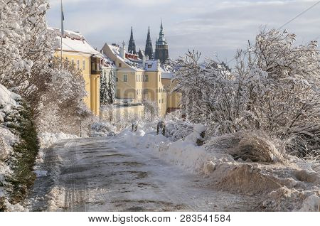 Winter view of snowy Saint Vitus Cathedral and Hradcany from Petrin hill. Prague, Czech Republic stock photo