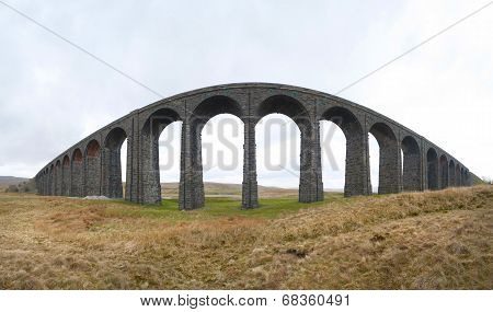 Wide angle panoramic view of the old stone arches of the Victorian railway viaduct over the River Ribble known as the Ribblehead Viaduct North Yorkshire stock photo