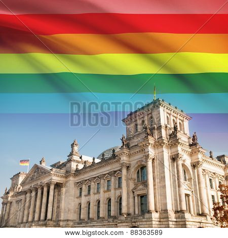 Reichstag building in Berlin with flag on background - LGBT people