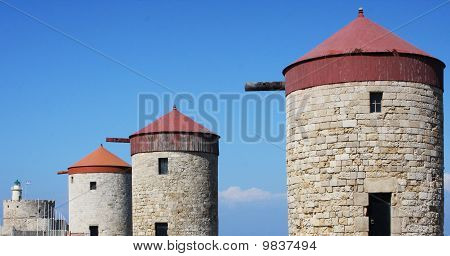 Beautiful windmills without fins on a sunny beach stock photo