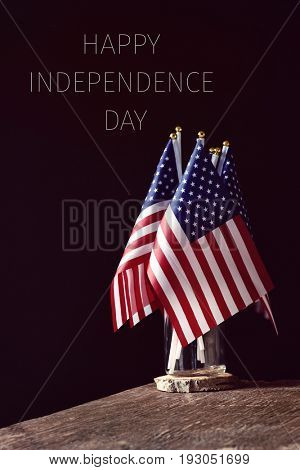 some american flags in a glass jar, on a rustic wooden surface and the text happy happy independence-Lg Fridge Magnet Skin (size 36x65)