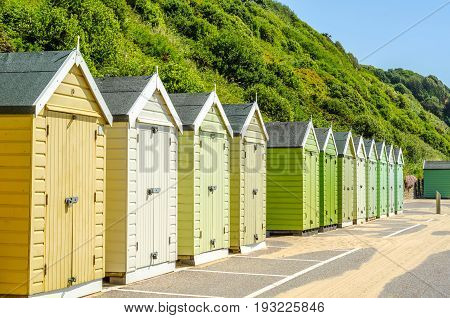Colored houses on the beach colorful door to summer cottages seaside spot sunny day stock photo