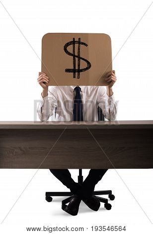 Businessman in the office holds a cardboard with the dollar symbol stock photo