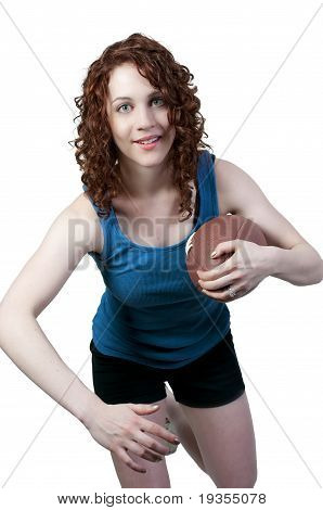 beautiful young woman playing a game of football running with the ball stock photo